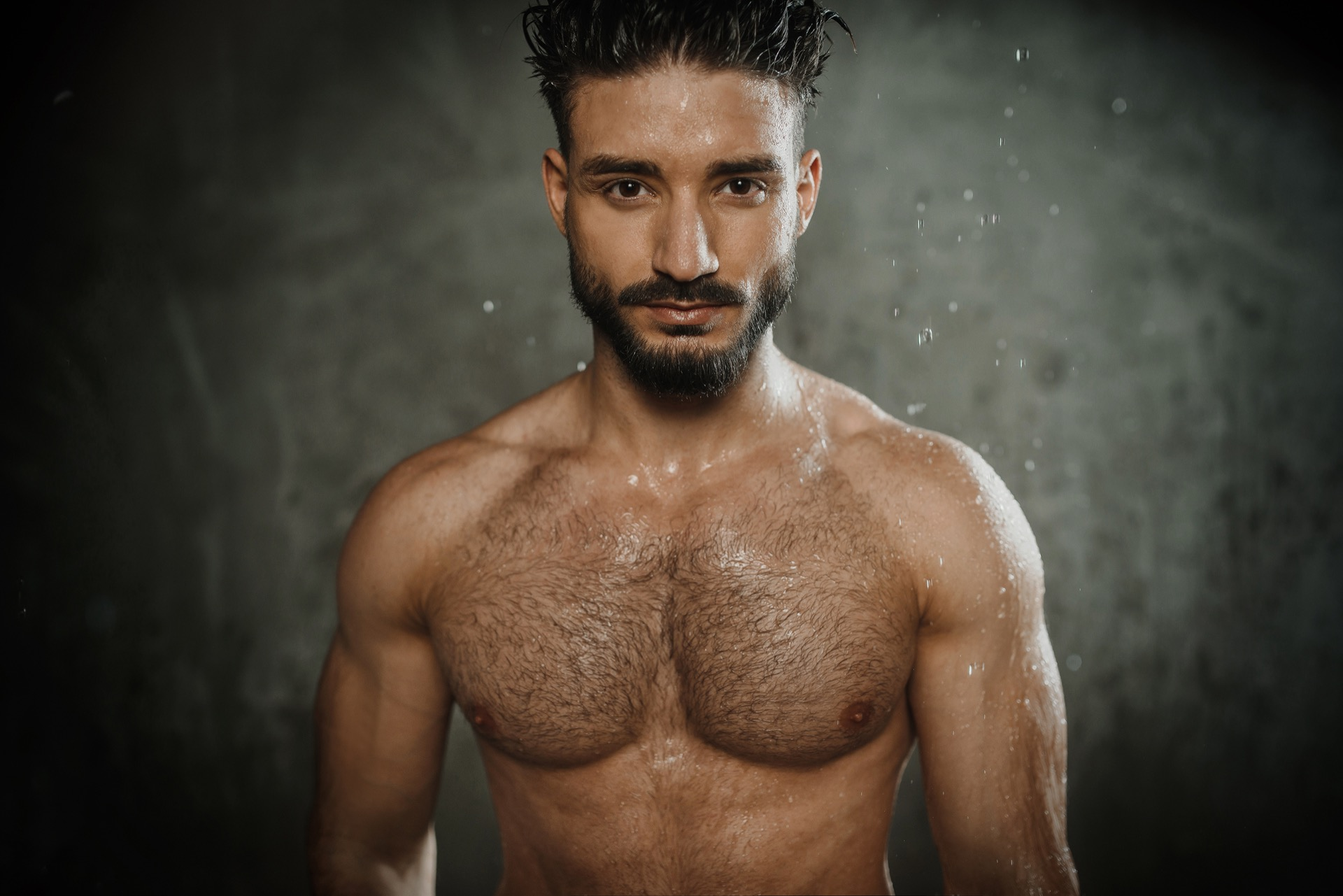 sexy man with drops of water